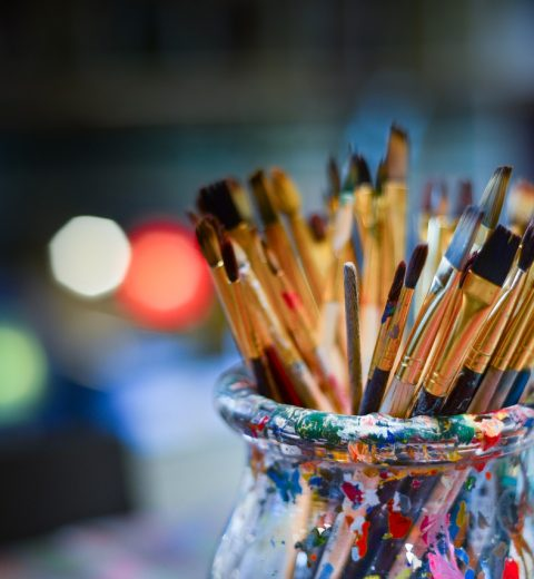 paint brushes in glass