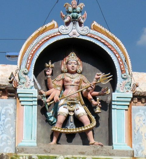 kalabhairava sculpture on top of his temple shrine