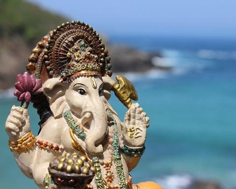 Lord Ganesha w modaka by the ocean