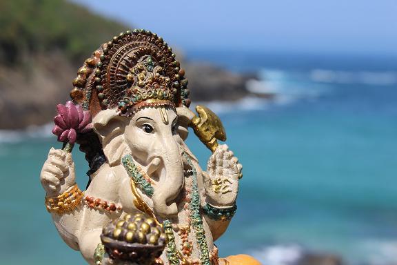 Lord Ganesha w modaka by the ocean